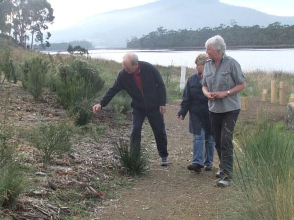 Landcare volunteers Alan and Loris Patman walking the revegetated riverbank