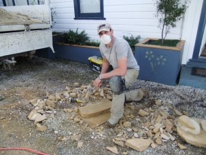 Chris making large sandstone jigsaw pieces